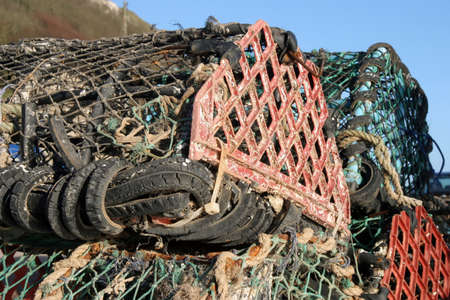 lobster pots: Lobster pots on the dockside at Seaton, Devon. Stock Photo