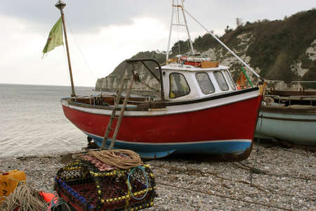 crab pots: Fishing Boats in the bay of Beer, Devon.