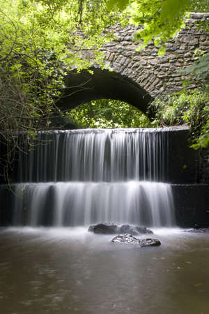 A Waterfall under a Bridge in Honiton, Devon.U.K