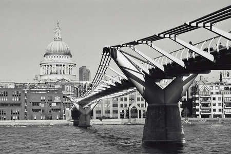 The Milleneum Bridge over the river Thames with St Pauls in the Background. Stock Photo - 702026