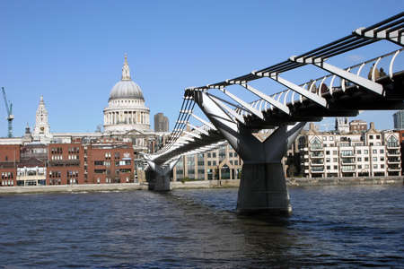The Milleneum Bridge over the river Thames with St Pauls in the Background. Stock Photo