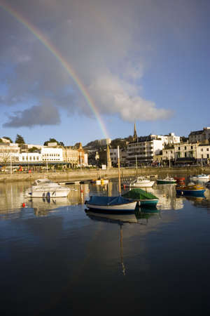 A rainbow over the town of Torquay, Devon. Stock Photo - 712452