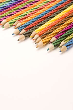 Coloured Pencils set against a Plain Background. Stock Photo