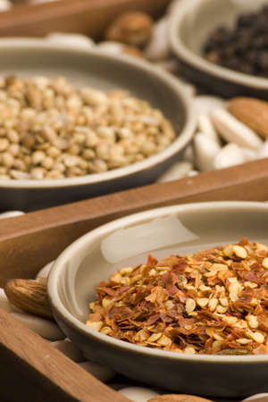 Dried Chilli and various spices close up in a wooden tray. Stock Photo - 774702