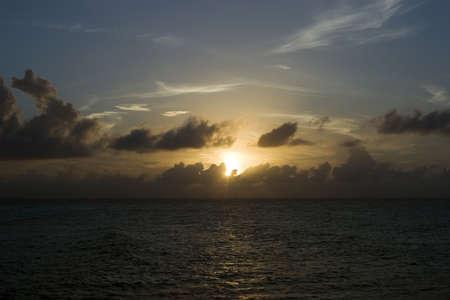 mujeres: A sunset over the sea in Isla Mujeres, Mexico