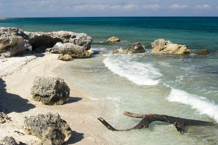 mujeres: Rocks and waves in Isla Mujeres, Mexico. Stock Photo
