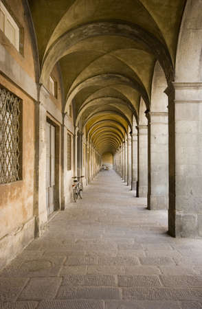 tuscana: An arched passageway in the town of Lucca, Italy.