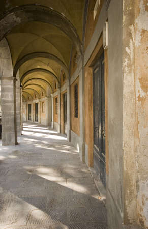 An arched passageway in the town of Lucca, Italy.