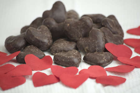 Multiple Chocolate love hearts with red paper hearts Stock Photo - 2119631