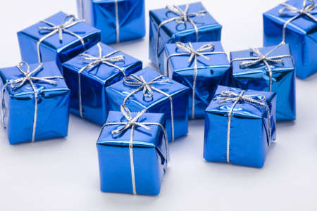 Blue gift boxes against a plain background