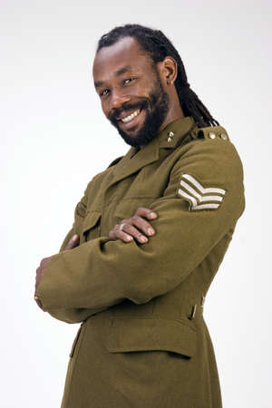 A Black man in a Army jacket isolated on a white background. Stock Photo