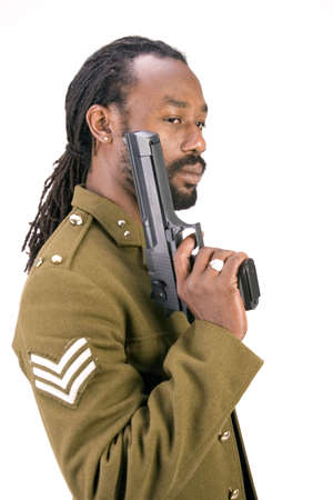 A Black man in a Army jacket with a gun isolated on a white background. Stock Photo
