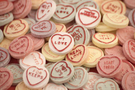 Love heart candy isolated on a Red Background. Stock Photo