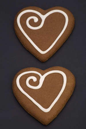 Love heart Cookies isolated on a Black Background. photo