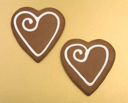 kiss biscuits: Love heart Cookies isolated on a gold Background.