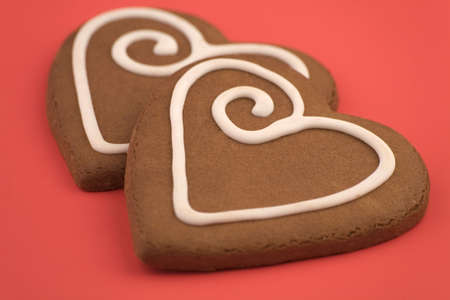 kiss biscuits: Love heart Cookies isolated on a Red Background.