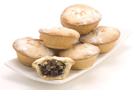 Multiple Mince Pies on a Plate isolated on a White background. Stock Photo