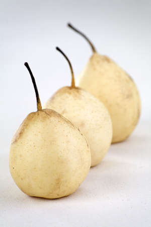 asian pear: Three Asian pear fruit on a linen background.