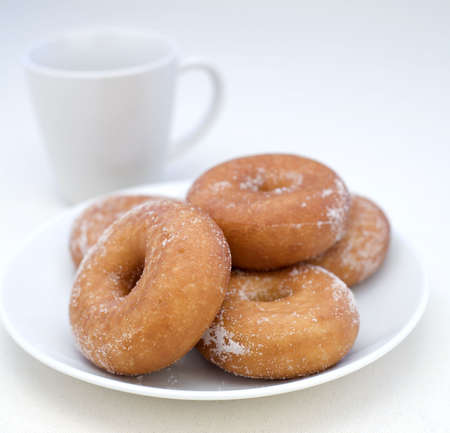 Donuts with coffee on a Linen background. Stock Photo