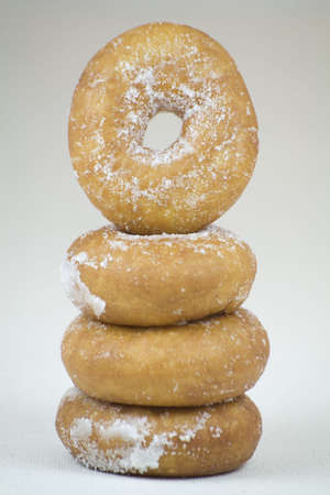A tower of Donuts on a plate on a Linen background. Stock Photo