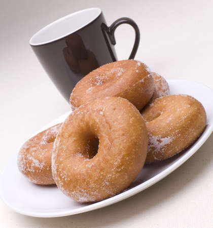Donuts with coffee on a Linen background. Фото со стока