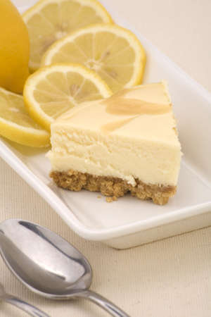 A lemon cheesecake on a linen background. Stock Photo