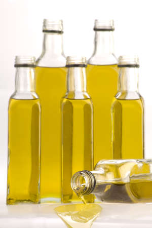 Multiple bottles of Olive oil isolated a white background.