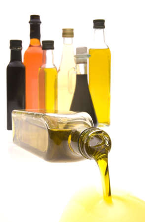 Olive oil and Balsamic vinegar bottles isolated on a high white background Stock Photo