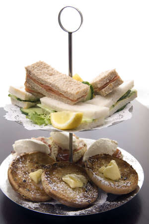 An arrangement of sandwiches and scones for afternoon tea photo