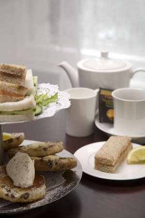 An arrangement of sandwiches and scones for afternoon tea Stock Photo
