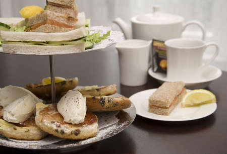 afternoon tea: An arrangement of sandwiches and scones for afternoon tea Stock Photo