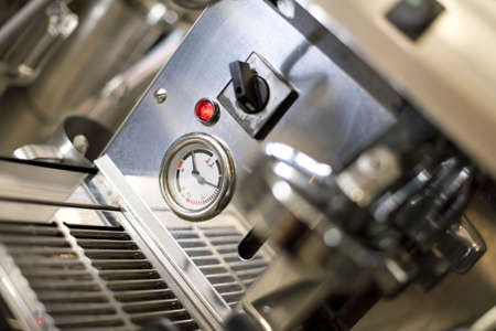A Temperature gauge on a coffee machine.