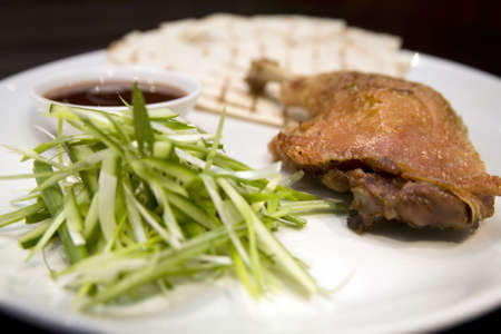 Crispy duck leg with spring onions and plum sauce