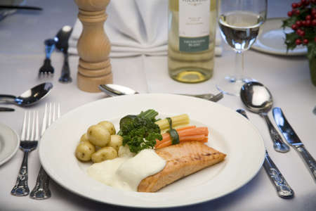 brocolli: a dinner plate of grilled Salmon with potatos and vegetables Stock Photo