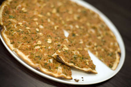 pine kernels: A Turkish style Minced lamb and Pine Kernels pizza