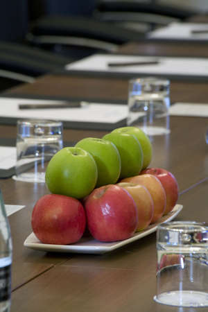 Boardroom place setting with a bowl of apples. Stock Photo - 4946699