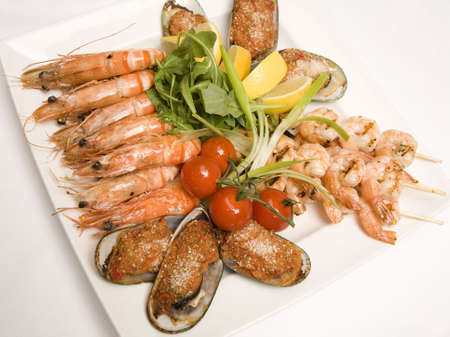A Sea food platter with salad on a plate Stock Photo