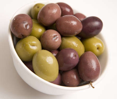 A bowl of Mixed olives isolated on a white background