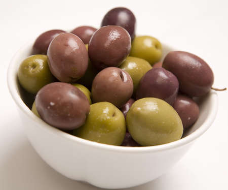 A bowl of Mixed olives isolated on a white background photo