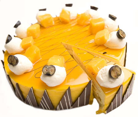 A portion of Mango cheesecake isolated on a white background.