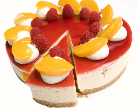 A portion of Raspberry & Mandarin cheesecake Stock Photo