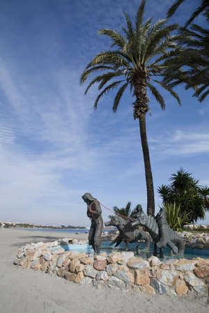 Palm trees along a beach promenade in Los Alcazares, Murcia. Spain. Stock Photo - 6081014