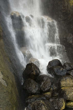 A cascade of flowing water from a waterfall. Stock Photo - 6150676