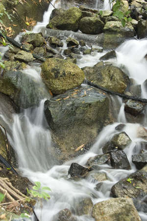 A cascade of flowing water from a waterfall. Stock Photo - 6150674