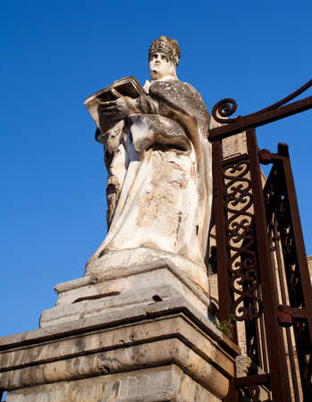 A statue on the outside of The Cathedral-Basilica of Cefalù