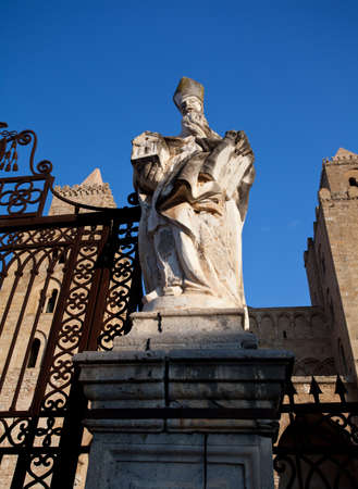 A statue on the outside of The Cathedral-Basilica of Cefalu