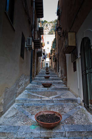 A narrow Cefalu street in Sicily  Stock Photo - 18811635