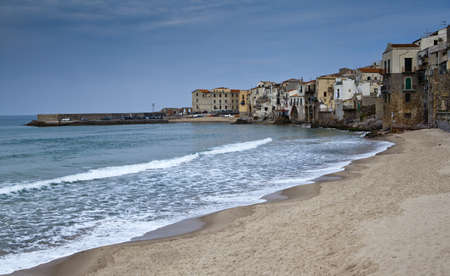 The harbour and beech of Cefalu in Sicily