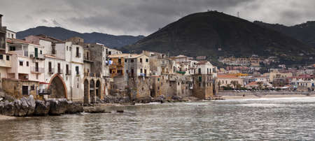 A seascape of the historic town of cefalu in Sicily  Stock Photo - 18811196