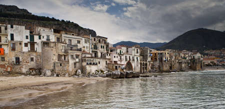 A seascape of the historic town of cefalu in Sicily